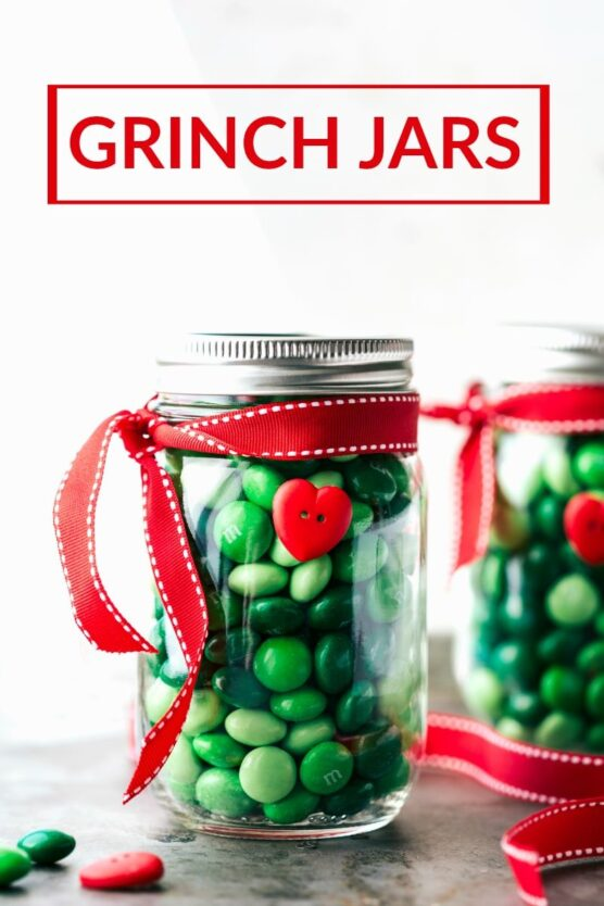 Green M&M's inside mason jars with red ribbons tied around them