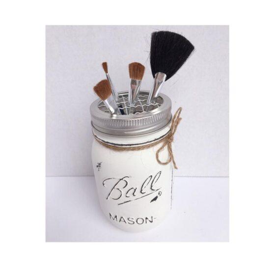 Makeup brushes in mason jar brush holder
