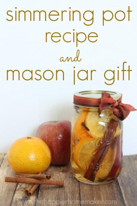 Orange slices, apple peels, cloves, and cinnamon sticks in a mason jar