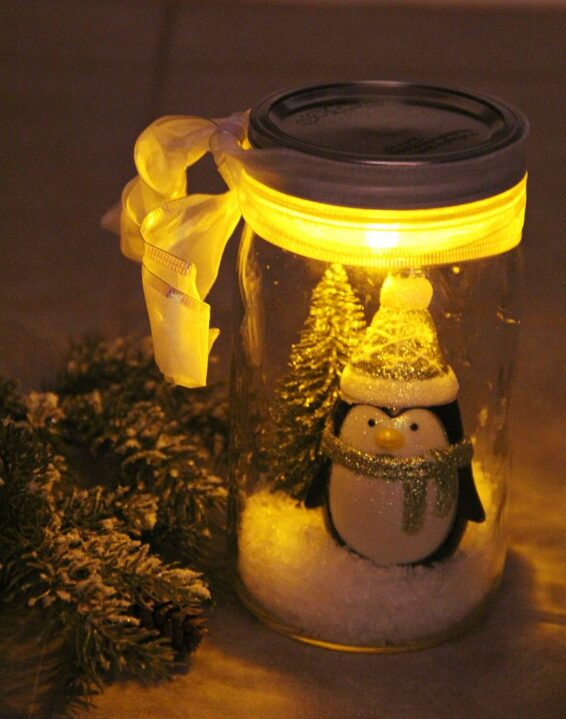 An illuminated snow scene in a jar